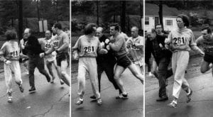 Woman Being Pulled Off a Marathon Course